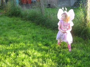 Sunny garden and a little fairy