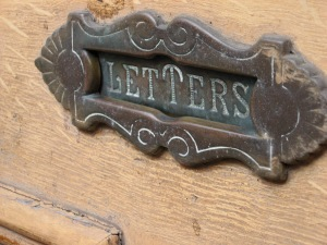 Ornate old letter slot.